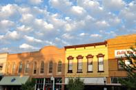 """<p>Though it's technically the sixth largest city in Kansas, downtown Lawrence has such a quaint feel that it had to be included in this list. No visit is complete without a stop to the <a href=""""http://www.mrsmass.com/2012/02/26/antique-mall/"""" rel=""""nofollow noopener"""" target=""""_blank"""" data-ylk=""""slk:Antique Mall"""" class=""""link rapid-noclick-resp"""">Antique Mall</a> on Mass Street, where you can spend an entire day wandering among the treasures.</p>"""