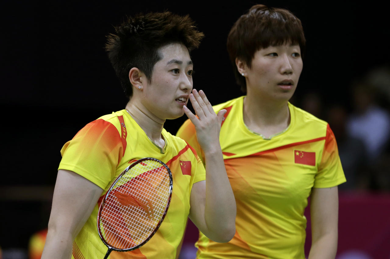 China's Yu Yang, left, and Wang Xiaoli talk while playing against Jung Kyun-eun and Kim Ha-na, of South Korea, in a women's doubles badminton match at the 2012 Summer Olympics, Tuesday, July 31, 2012, in London. World doubles champions Wang and Yu, and their South Korean opponents were booed loudly at the Olympics on Tuesday for appearing to try and lose their group match to earn an easier draw. (AP Photo/Andres Leighton)