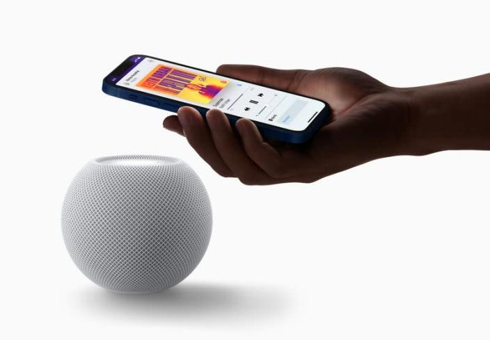 Apple's HomePod mini is seen with an iPhone in a photograph released in Cupertino