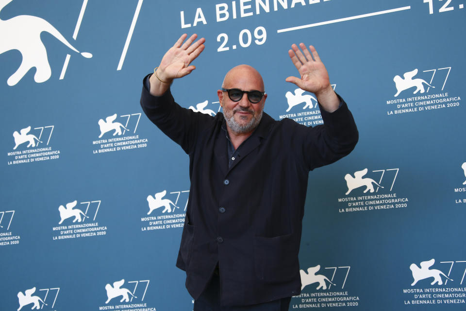 Director Gianfranco Rosi poses for photographers at the photo call for the film 'Notturno' during the 77th edition of the Venice Film Festival in Venice, Italy, Tuesday, Sept. 8, 2020. (Photo by Joel C Ryan/Invision/AP)