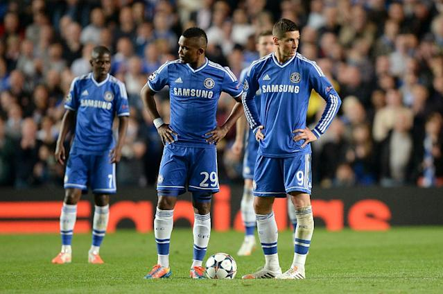 Chelsea's Fernando Torres, right, and Samuel Eto'o, center, stand dejected after conceding a second goal during the Champions League semifinal second leg soccer match between Chelsea and Atletico Madrid at Stamford Bridge stadium in London, Wednesday, April 30, 2014. (AP Photo/Andrew Matthews, PA Wire)