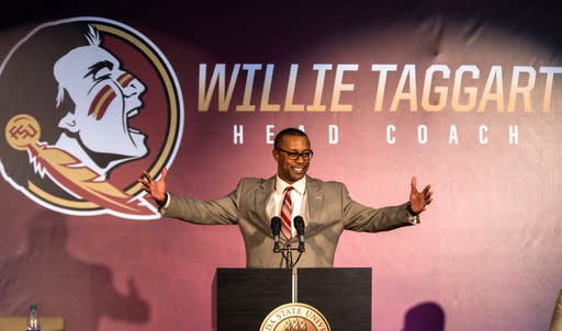 FILE - In this Dec. 6, 2017, file photo, Willie Taggart gestures as he is introduced as Florida State's new football coach during an NCAA college football news conference in Tallahassee, Fla. Taggart, the conference's only new coach in 2018, is taking over for Jimbo Fisher at Florida State and one of his first moves was to reconnect the Seminoles tradition-rich past with their present _ even bringing back Bobby Bowden for the spring game (AP Photo/Mark Wallheiser, File)