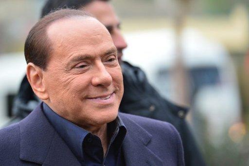 Sparks with Berlin as Berlusconi kicks off campaign