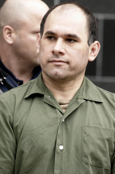 "FILE - In a Friday, Feb. 9, 2007 file photo, accused Mexican drug kingpin Osiel Cardenas-Guillen, 39, leaves the federal courthouse in Houston after pleading not guilty to charges connected to running a cartel that at its height smuggled four to six tons of cocaine per month into the country. Cardenas-Guillen's nephew Rafael Cardenas Vela, a Gulf cartel member of distinguished lineage who ran three important ""plazas"" or territories, recently testified to the organization's structure and operations in such detail that it could compose a short course _ Narco 101, perhaps. (AP Photo/Pat Sullivan, File)"