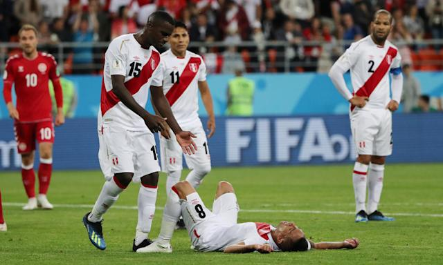 Christian Cueva is consoled by his teammates after Peru's defeat to Denmark.