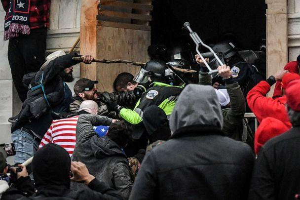 PHOTO: Supporters of U.S. President Donald Trump battle with police at the west entrance of the U.S. Capitol building during a riot in Washington, D.C., on Jan. 6, 2021. (Stephanie Keith/Reuters)