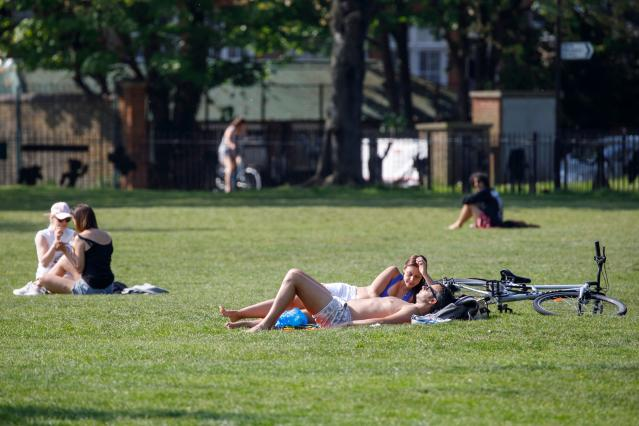 Sunbathers flocked to parks and beauty spots at the weekend despite national lockdown rules imposed to stop the spread of COVID-19. (Tolga AKkmen/AFP via Getty Images)