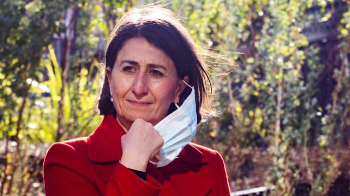 NSW Premier Gladys Berejiklian removes her mask at a press conference and Covid-19 update on June 26, 2021 in Sydney