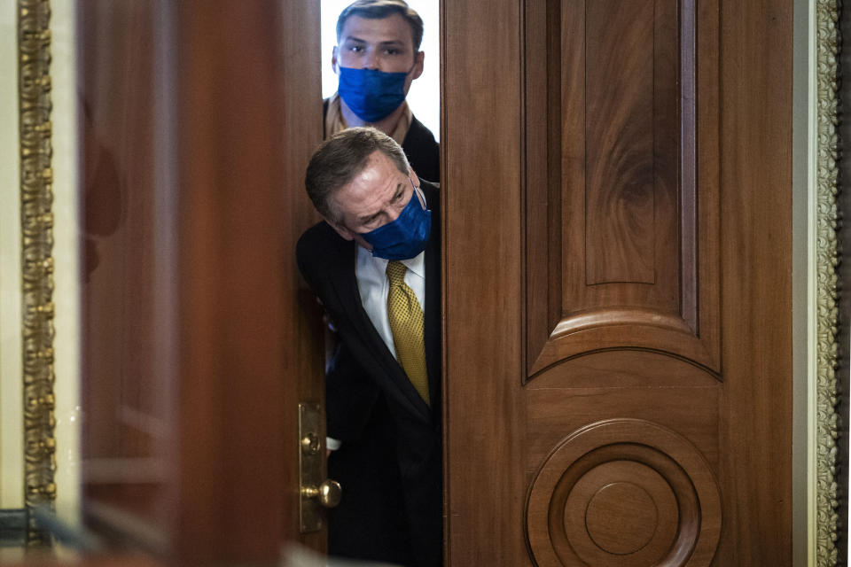 Michael van der Veen, lawyer for former President Donald Trump, looks out from the Senate floor to the Senate Reception room on the fourth day of the Senate Impeachment trials for Trump on Capitol Hill, Friday, Feb 12, 2021 in Washington. (Jabin Botsford/The Washington Post via AP, Pool)