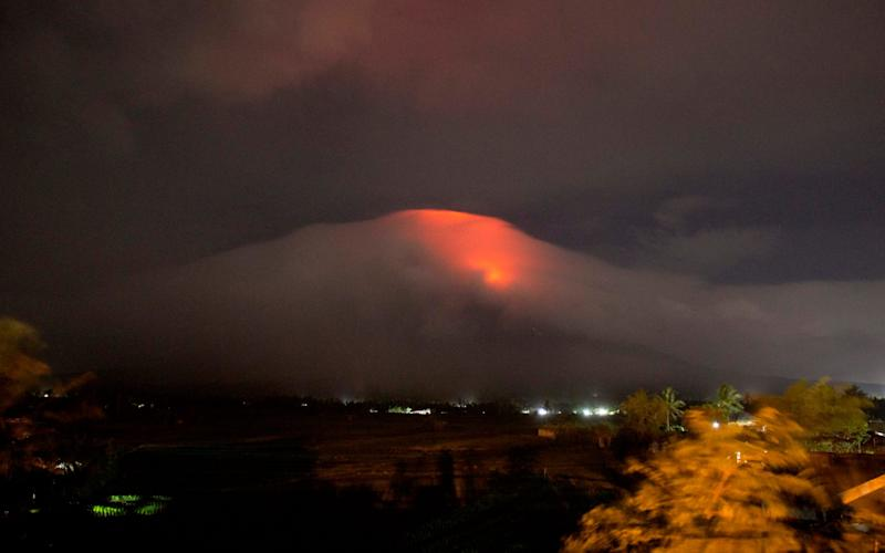 The Philippines' most active volcano rumbled back to life Sunday with lava rising to its crater - Earl Recamunda