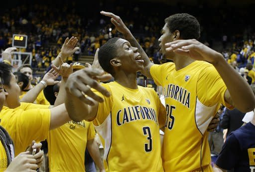 California guard Tyrone Wallace (3) is greeted by teammate Richard Solomon, right, and fans at the end after their NCAA college basketball game against Oregon Saturday, Feb. 2, 2013 in Berkeley, Calif. California won the game 58-54. (AP Photo/Eric Risberg)