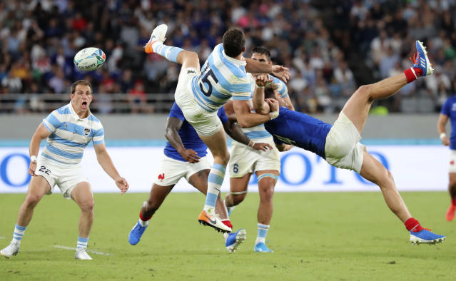Argentina's Emiliano Boffelli, left, and France's Damian Penaud collide as they leap for the ball during the Rugby World Cup Pool C game at Tokyo Stadium between France and Argentina in Tokyo, Japan, Saturday, Sept. 21, 2019. (AP Photo/Eugene Hoshiko)