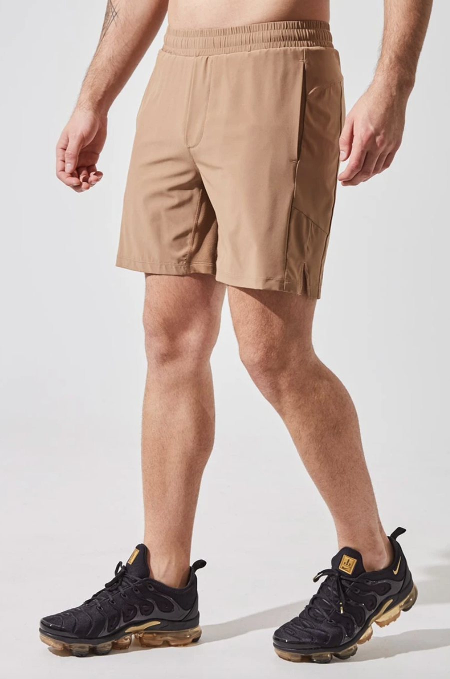 """Catch 7"""" Recycled Polyester Short with Liner in Camel (Photo via MPG)"""