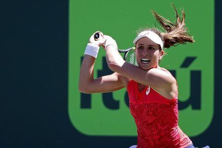 Mar 29, 2017; Miami, FL, USA; Johanna Konta of Great Britain hits a backhand against Simona Halep of Romania (not pictured) on day nine of the 2017 Miami Open at Crandon Park Tennis Center. Geoff Burke-USA TODAY Sports