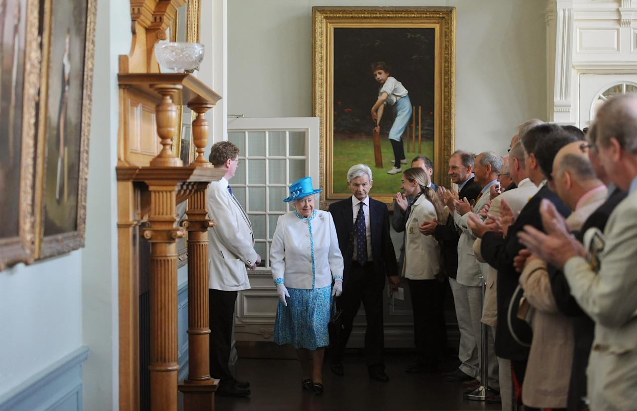 LONDON, UNITED KINGDOM - JULY 18:  Queen Elizabeth II walks through the Long Room inside the Pavilion ahead of the first day of the second test between England and Australia at Lord's Cricket Ground on July 18, 2013 in London, England.  (Photo by Anthony Devlin - WPA Pool/Getty Images)