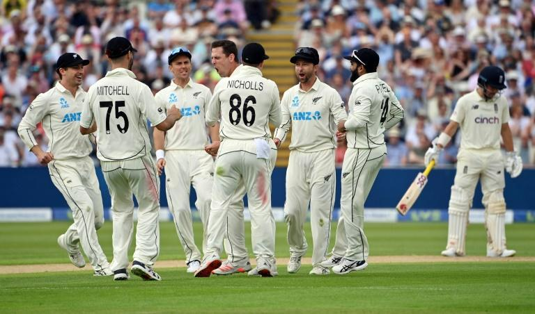 Big blow - New Zealand's Matt Henry (C) celebrates with team-mates after dismissing England captain Joe Root for four on Thursday
