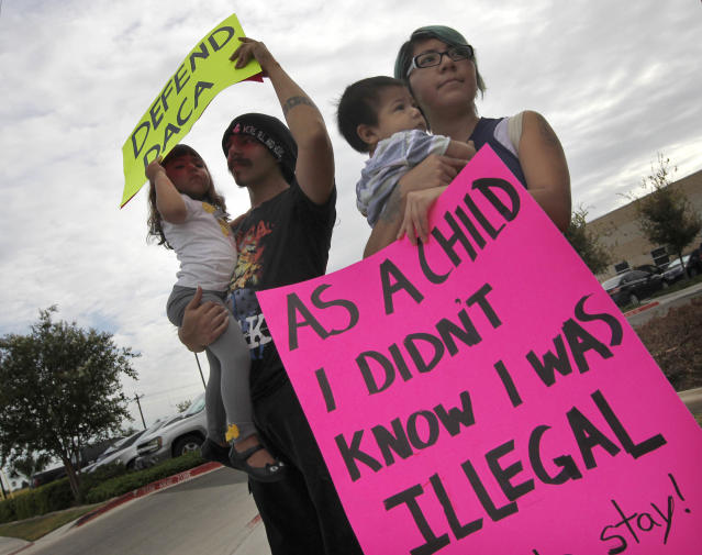 <p>Kathia Ramirez, right, holds her son Rowen Salinas, 11 months, as her husband, Randy Salinas, holds their daughter Fridah Salinas, 2, during a protest in favor of Deferred Action for Childhood Arrivals (DACA), Tuesday, Sept. 5, 2017, in front of the Texas Attorney General's office in Pharr, Texas. Ramirez, 24, was brought to the U.S. when she was 7-years old, her husband and children are all U.S. citizens. (Photo: Nathan Lambrecht/The Monitor via AP) </p>