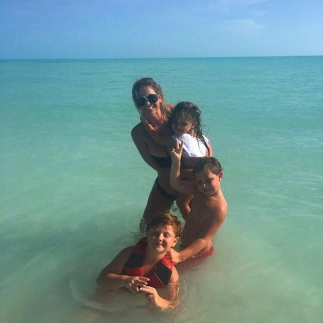 """<p>It seems like they've been on vacation forever! Kim, 39, has been posting bikini pics for weeks, including this shot of her wading in the water with three of her children, """"My gang."""" (Photo: <a href=""""https://www.instagram.com/p/BVFoAwMhfR6/"""" rel=""""nofollow noopener"""" target=""""_blank"""" data-ylk=""""slk:Kim Zolciak via Instagram"""" class=""""link rapid-noclick-resp"""">Kim Zolciak via Instagram</a>) </p>"""