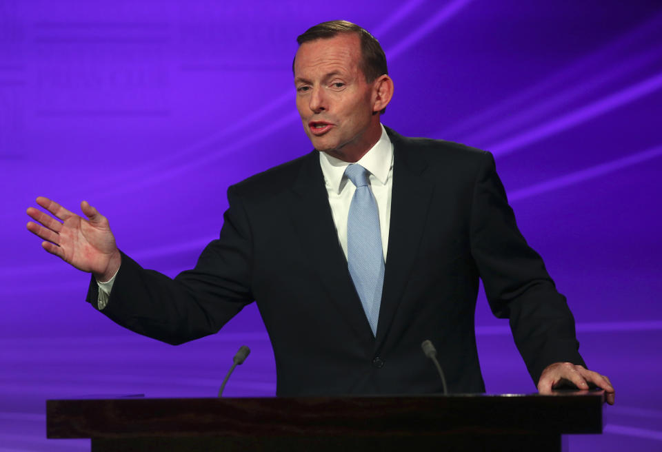 Leader of the conservative opposition Tony Abbott speaks during a debate with the Australian Prime Minister and leader of the Australian Labor Party Kevin Rudd at the National Press Club in Canberra August 11, 2013. Australia will hold a federal election on September 7.  REUTERS/Andrew Meares/Pool    (AUSTRALIA - Tags: POLITICS ELECTIONS)