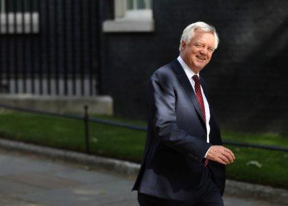 FILE PHOTO: Britain's Secretary of State for Exiting the European Union David Davis walks down Downing Street in London, Britain, July 4, 2018. REUTERS/Simon Dawson