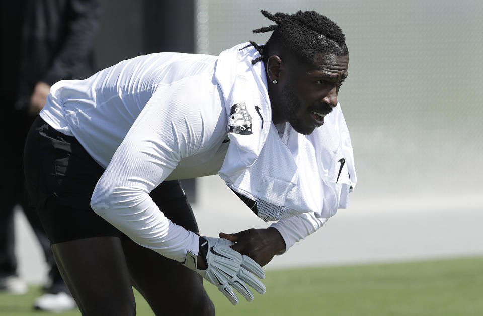 Oakland Raiders wide receiver Antonio Brown has been sitting out of practice due to his feet. (AP)