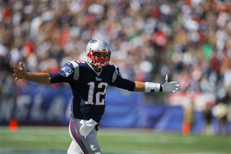 New England Patriots quarterback Brady celebrates after Patriots scored touchdown on pass to Patriots wide receiver Thompkins in first half of their NFL football game against Tampa Bay Buccaneers in Foxborough