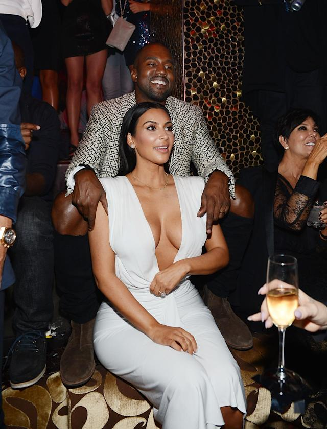 Kanye West helped Kim Kardashian celebrate her birthday at Tao nightclub at the Venetian in Las Vegas in 2014. He even smiled. (Photo: Getty Images)