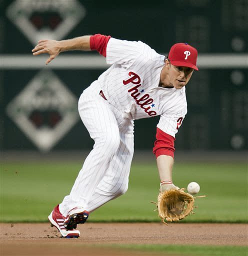 Philadelphia Phillies second baseman Chase Utley fields a ground ball during the first inning of a baseball game against the New York Mets, Monday, April 8, 2013, in Philadelphia. (AP Photo/Tom Mihalek)