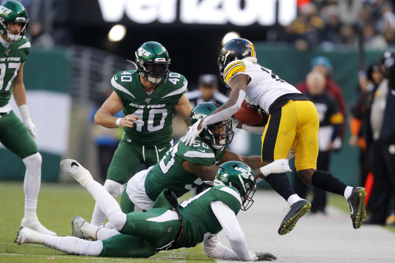 Pittsburgh Steelers wide receiver Diontae Johnson (18) is stopped by New York Jets linebacker Frankie Luvu (50)in the second half of an NFL football game, Sunday, Dec. 22, 2019, in East Rutherford, N.J. (AP Photo/Adam Hunger)