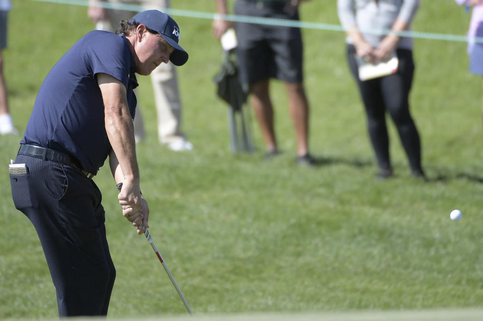 Phil Mickelson chips onto the second green during the second round of the Arnold Palmer Invitational golf tournament at Bay Hill, Friday, March 8, 2019, in Orlando, Fla. (AP Photo/Phelan M. Ebenhack)