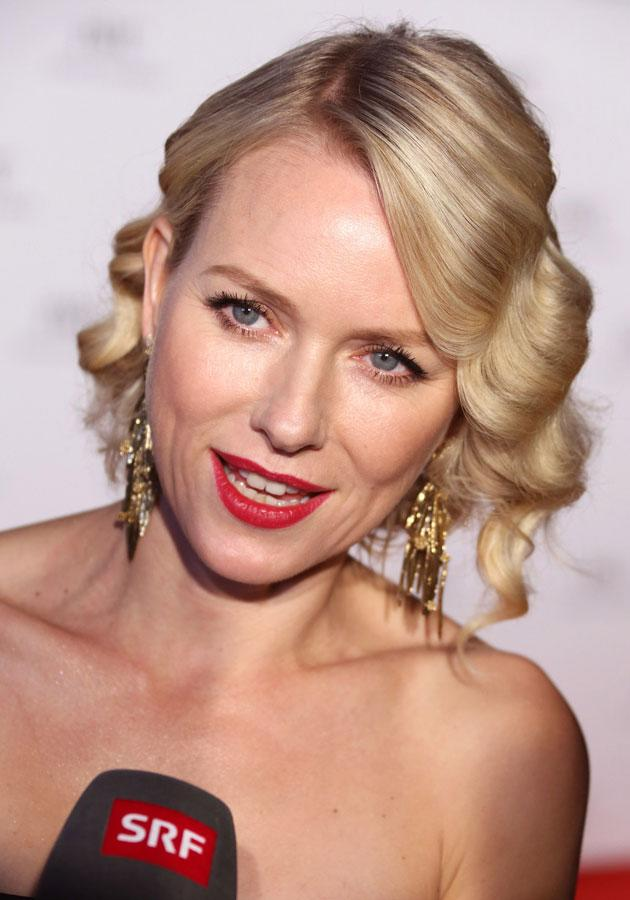 Celebrities wearing red lipstick: Naomi Watts worked the red lips trend with a chic up-do at Cannes.<p>[Rex]</p>