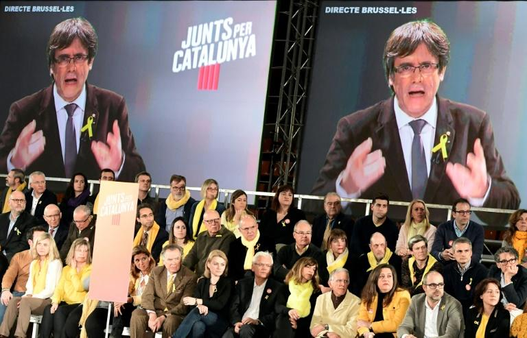 Deposed regional president Carles Puigdemont spoke via video-conference from his self-imposed exile in Brussels during a campaign meeting in Barcelona