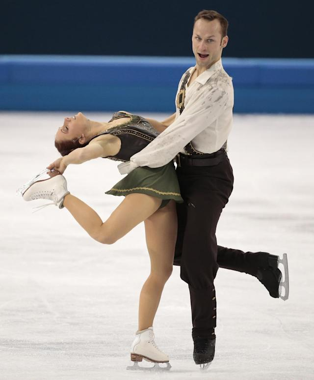 Maylin Wende and Daniel Wende of Germany compete in the pairs free skate figure skating competition at the Iceberg Skating Palace during the 2014 Winter Olympics, Wednesday, Feb. 12, 2014, in Sochi, Russia. (AP Photo/Ivan Sekretarev)