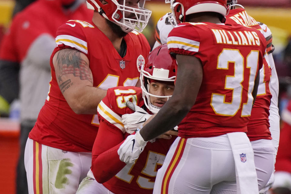 Kansas City Chiefs quarterback Patrick Mahomes (15) is helped up by teammates after getting injured during the second half against the Browns. (AP Photo/Charlie Riedel)