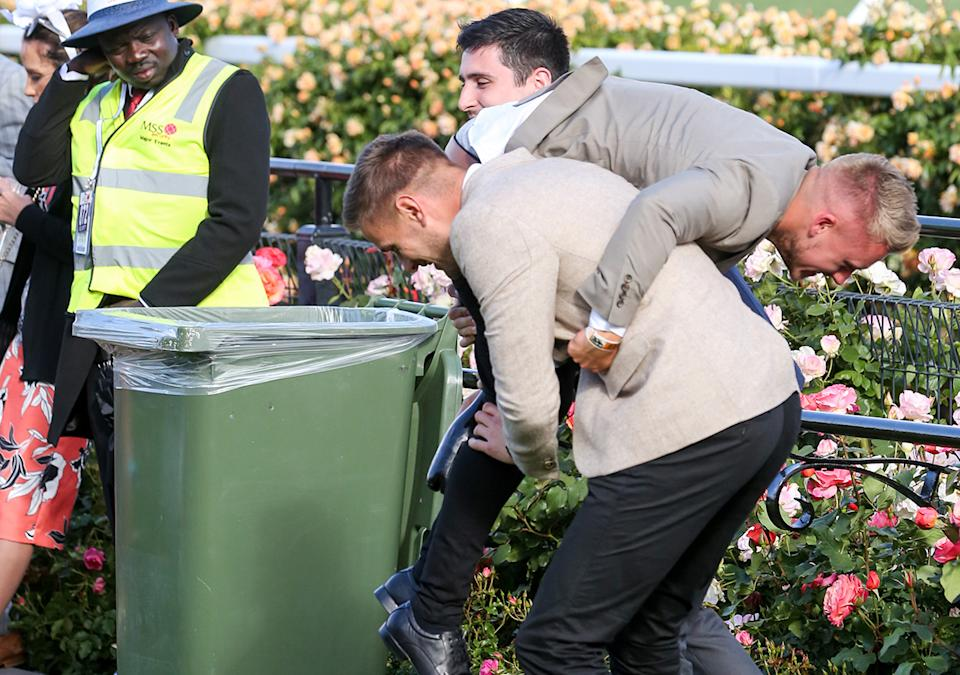 Drunk punters, pictured here wrestling at the end of the 2017 Melbourne Cup.