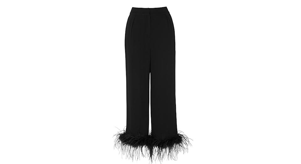 """<p>Pair these fantastic, statement trousers with a printed blouse or a cashmere jumper. <a rel=""""nofollow noopener"""" href=""""https://kitristudio.com/collections/fresh-in/products/kiki-feather-trousers"""" target=""""_blank"""" data-ylk=""""slk:Buy here."""" class=""""link rapid-noclick-resp""""><em>Buy here.</em></a> </p>"""
