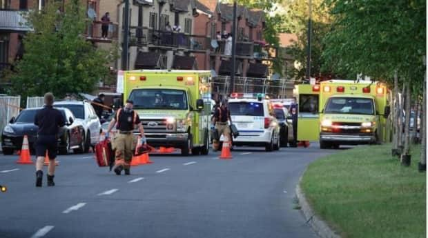 Five people were shot in an apartment building in the Rivière-des-Prairies neighbourhood Monday night. Three of the victims later died in hospital.   (Mathieu Wagner/Radio-Canada - image credit)