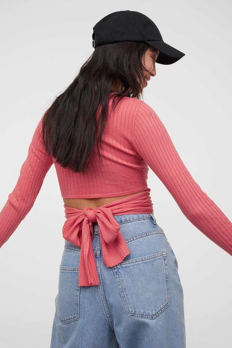 <p>The back of this <span>H&amp;M Tie-Detail Top</span> ($25) is the best part! I'd style mine with a floral midi skirt.</p>