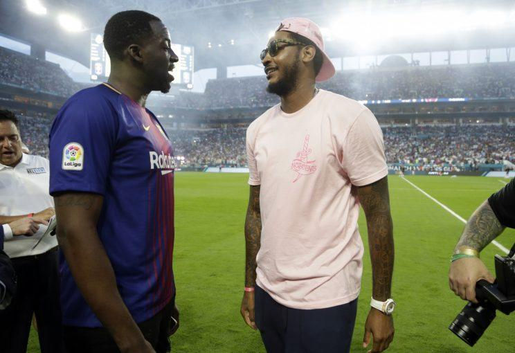 Draymond Green, left, and Carmelo Anthony talk before an International Champions Cup soccer match between Barcelona and Real Madrid on Saturday in Miami Gardens, Florida. (AP)