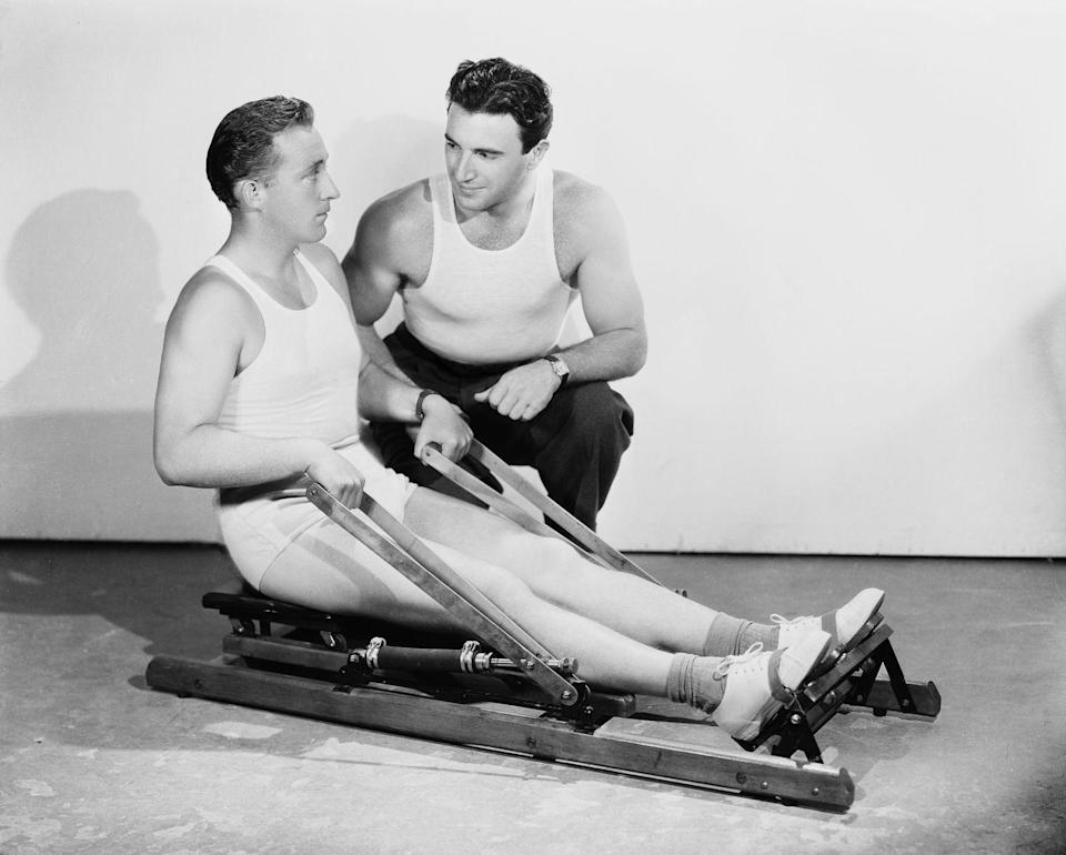 <p>Bing Crosby receives instruction on how to properly use an exercise machine at the fitness center in 1934. </p>