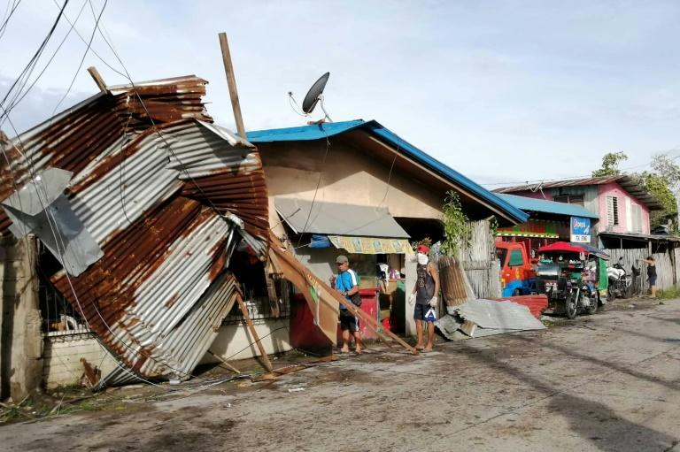 The typhoon has crumpled houses, toppled trees and blacked out cities and towns