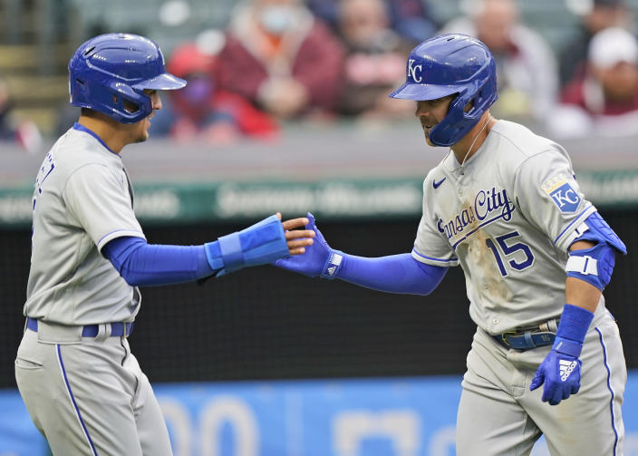 Kansas City Royals Whit Merrifield, right, is congratulated by Nicky Lopez after Merrifield hit a two-run home run in the second inning of a baseball game against the Cleveland Indians, Monday, April 5, 2021, in Cleveland. Lopez scored on the play. (AP Photo/Tony Dejak)