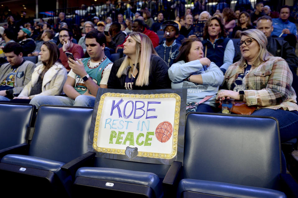 """A sign reading """"Kobe Rest In Peace"""" is displayed on an empty seat in the first half of a basketball game between the Phoenix Suns and the Memphis Grizzlies, Sunday, Jan. 26, 2020, in Memphis, Tenn. Former NBA player Kobe Bryant died in a California helicopter crash Sunday. (AP Photo/Brandon Dill)"""