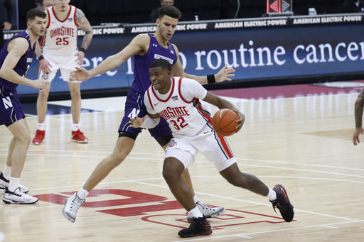 Ohio State's E.J. Liddell drives against Northwestern's Pete Nance during the second half of an NCAA college basketball game Wednesday, Jan. 13, 2021, in Columbus, Ohio. (AP Photo/Jay LaPrete)