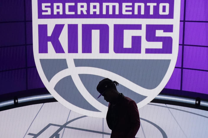 Davion Mitchell steps off the stage after being selected ninth overall by the Sacramento Kings during the NBA basketball draft, Thursday, July 29, 2021, in New York. (AP Photo/Corey Sipkin)