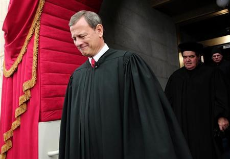 Supreme Court Chief Justice John Roberts and Supreme Court Justice Antonin Scalia arrive for the presidential inauguration on the West Front of the U.S. Capitol in Washington