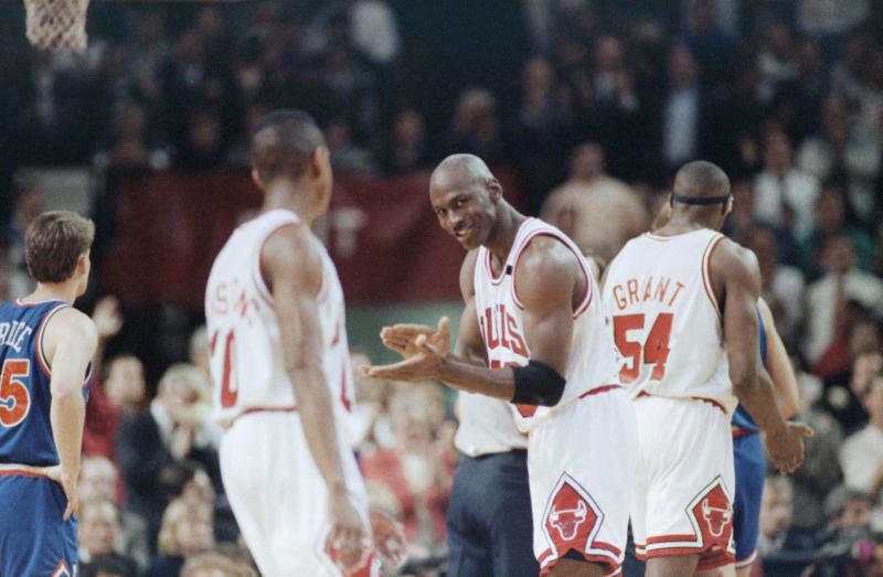 The Chicago Bulls Michael Jordan (23) laughs, with teammate Horace Grant (54) in the background, during the fourth quarter of Game 5 with the Cleveland Cavaliers in the Eastern Conference Final, Wednesday, May 28, 1992, Chicago, Ill. The Bulls beat the Cavs 112-89 to go up 3-2 in the best-of-seven series. (AP Photo/Fred Jewell)