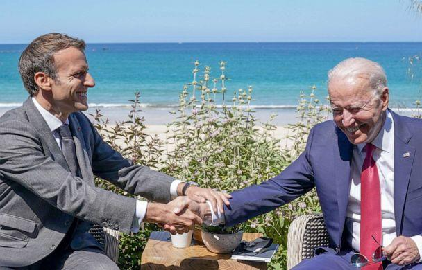 PHOTO: President Joe Biden and France's President Emmanuel Macron shake hands as they attend a bilateral meeting during the G7 summit in Carbis Bay, Cornwall, Britain, June 12, 2021.  (Kevin Lamarque/Reuters)