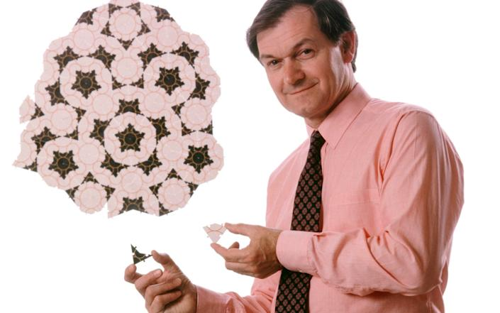 Roger Penrose (born 1931), British mathematician, with the Penrose tiling system named after him. Penrose, renowned for his work in mathematical physics, studied this tiling system in the 1970s. Using only two tiles of a particular shape, complex, non-repeating patterns can be generated. Penrose has also worked on black holes, cosmology, quantum mechanics and human consciousness. His awards include the Eddington Medal, the Royal Medal, the Wolf Prize, and the Albert Einstein Medal. Penrose was knighted in 1994. Photographed in 1989 - CORBIN O'GRADY/SCIENCE PHOTO LIBRARY