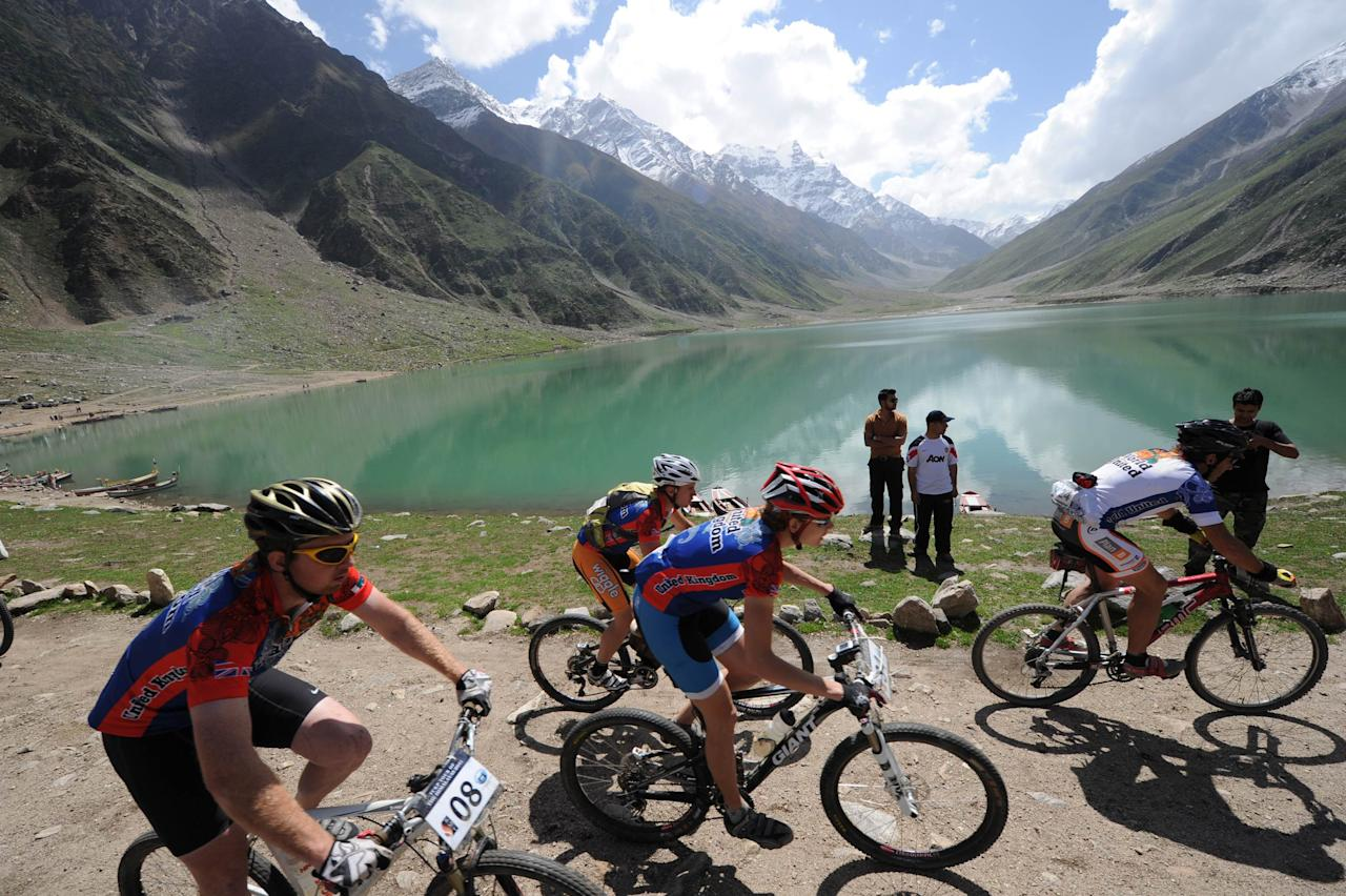 International cyclists ride during the second stage of the Himalayas 2011 International Mountainbike Race in the mountainous area of Lake Saif-ul-Maluk, in Pakistan's tourist region of Naran, in the Khyber Pakhtunkhwa province, on September 17, 2011. The cycling event, organised by the Kaghan Memorial Trust to raise funds for its charity school dedicated to children affected by the October 2005 earthquake and set up in the Kaghan valley, attracted some 30 International and 11 Pakistani cyclists. AFP PHOTO / AAMIR QURESHI (Photo credit should read AAMIR QURESHI/AFP/Getty Images)